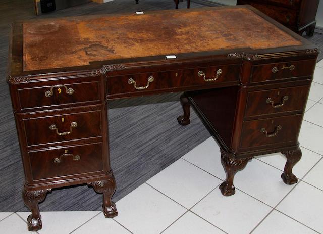 A 1920's mahogany twin pedestal desk,