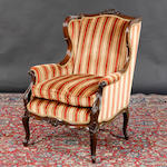 A Victorian upholstered wing-back chair