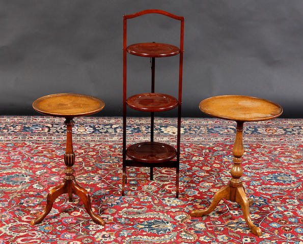 Two small circular side tables