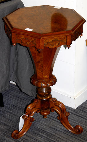 A Victorian walnut octagonal work table