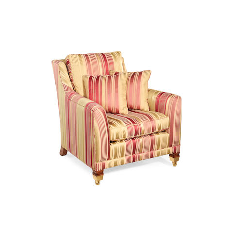 An upholstered armchair retailed by Harrods