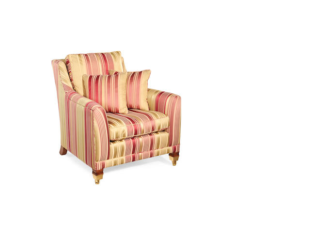 A stained beech armchair retailed by Harrods