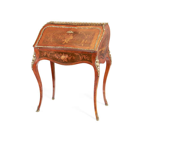 A French late 19th century brass mounted tulipwood, amaranth and marquetry bureau de dame in the Louis XV style