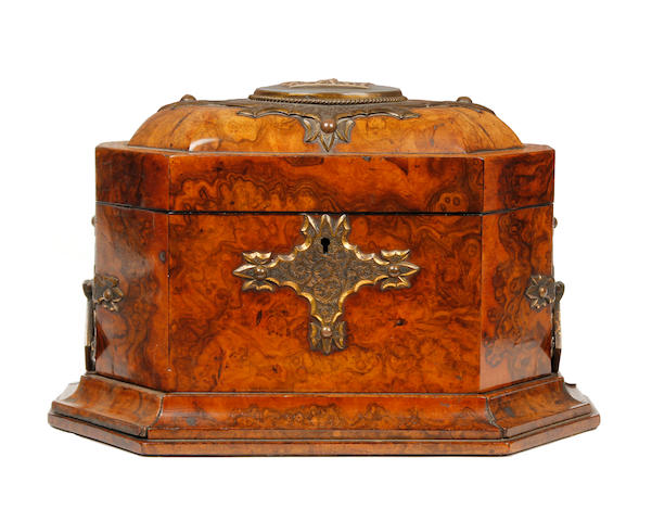 A Victorian figured walnut and gilt brass octagonal tea caddy