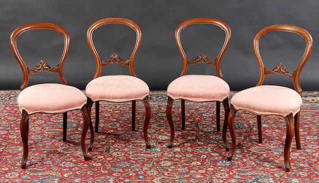 A set of four Victorian salon chairs