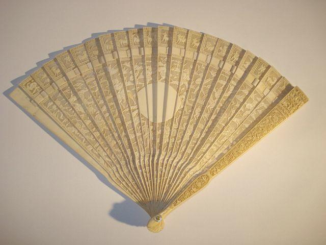 A Chinese carved ivory fan 19th Century