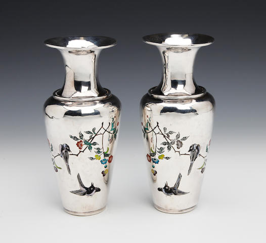 A Chinese silver and enamel pair of baluster vases bearing character marks, circa 1900