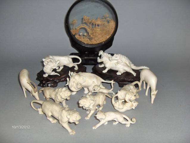 Ten Chinese carved ivory figures of wild animals