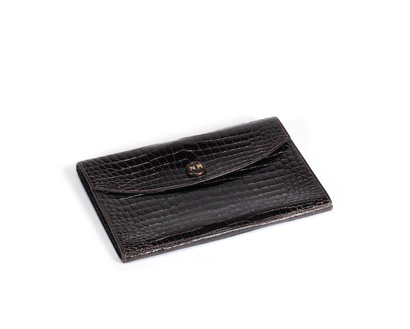 An Hermès dark brown crocodile Pochette