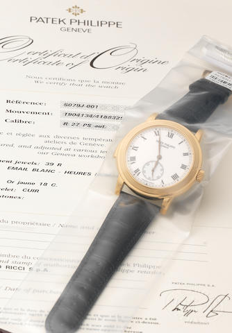 Patek Philippe. An exceptionally fine and rare 18ct gold automatic minute repeating wristwatch still sealed in its original plastic together with fitted presentation box and Certificate of Origin Ref:5079, Case No.4188329, Movement No.1904134,  Made Circa 2005