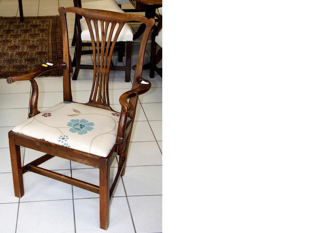 An 18th Century elm eblow chair,