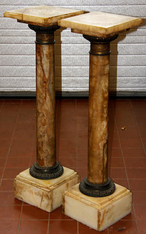 A pair of Victorian alabaster and gilt metal mounted cylindracl columns
