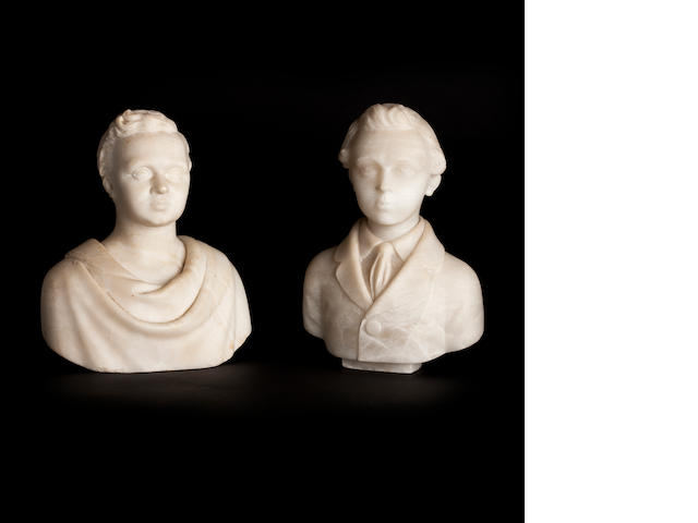 Two small carved alabaster portrait busts of young boys