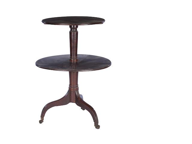 An early 19th century mahogany two tier dumb waiter