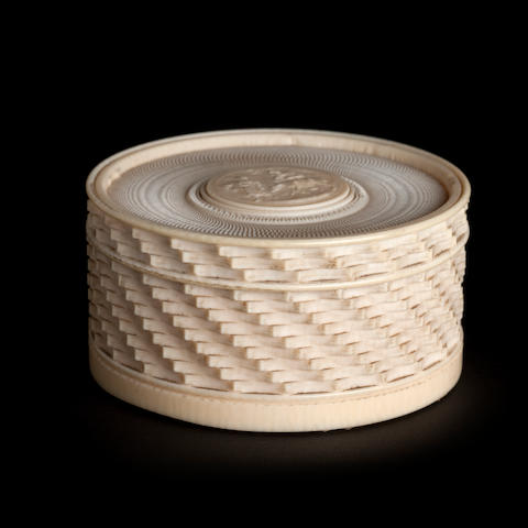 A 19th century French carved ivory circular box and cover