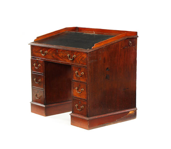 A late George III mahogany kneehole desk