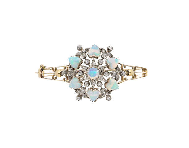 A late 19th century opal and diamond hinged bangle (illustrated above)