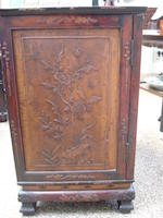 A finely carved and fitted stained wood cabinet Circa 1900