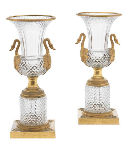 A pair of ormolu mounted glass vases