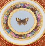 A Sevres 'marli rouge' butterfly plate with crack