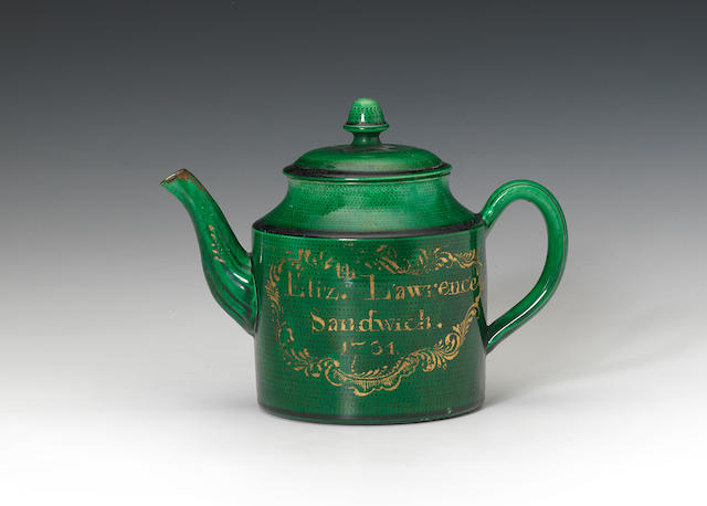 A green glazed teapot, dated 1791