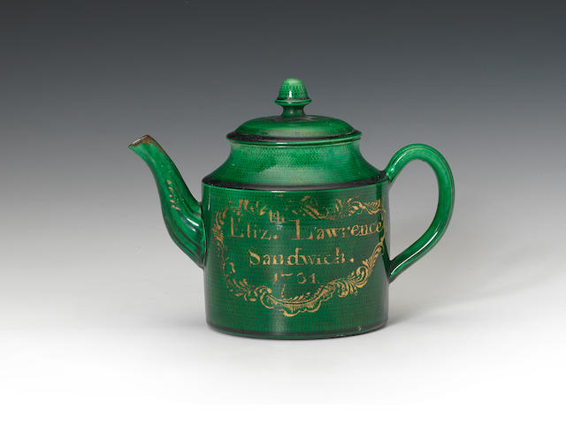 A green glazed teapot, dated 1781