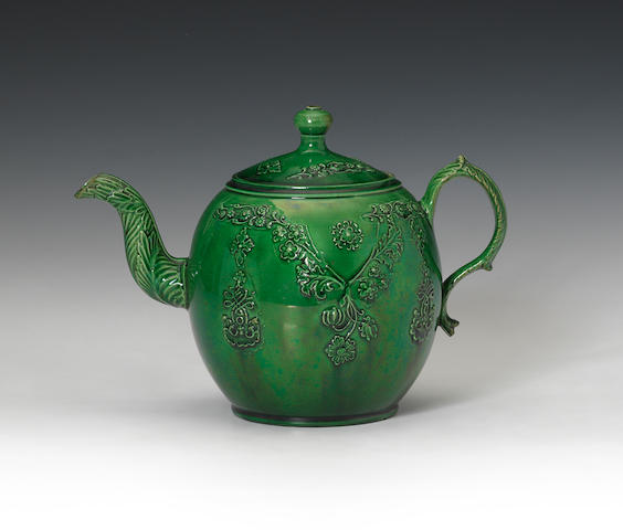 A green glazed cornucopia, a teapot, a bowl and a butter cup, circa 1760-70