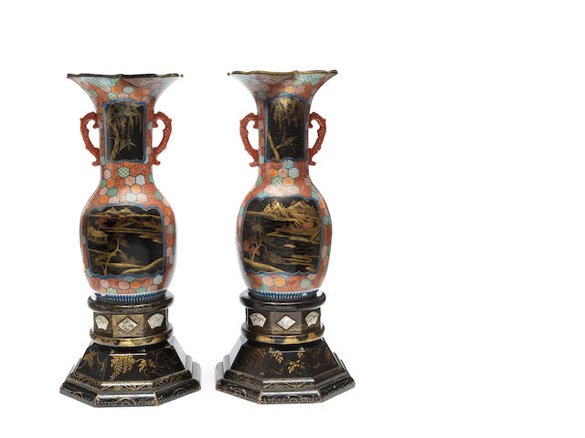 A pair of large Japanese porcelain vases on Japanned bases
