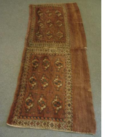 A pair of Yomut Chuvals,  each with three rows of quartered guls and a rust ground, 1.85m x 74cm.