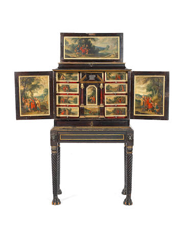 A Flemish 17th century parcel-gilt, tortoiseshell, ivory, ebony and ebonised cabinet, inset with painted copper panels of the life of Christ, on an Irish Regency stand