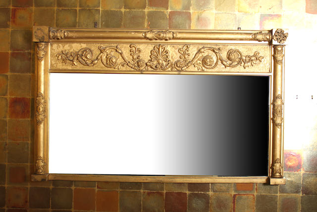 A late Regency giltwood and gesso overmantel mirror