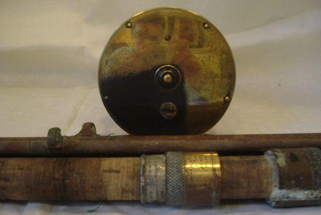 "A 19th Century  4 1/4"" brass fishing reel, engraved Patent Lever No. 798, Chas Farlow & Co, makers 191 Strand, London and a Hardy Bros Alnwick four part Salmon and trout rod,432cm total length."