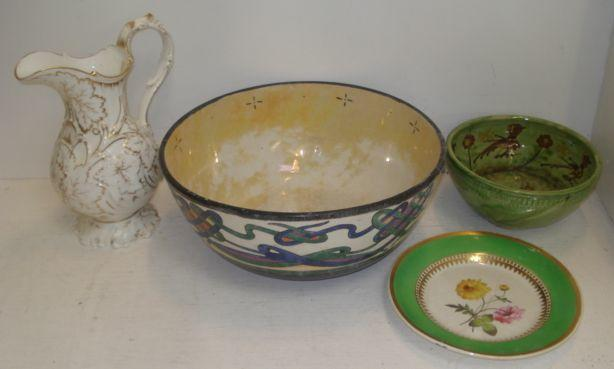 A large Arts & Crafts fruit bowl, the sides decorated with a band of strapwork in the Irish taste, 33.5cm, a Victorian gilt decorated leaf moulded baluster jug and other ceramics.