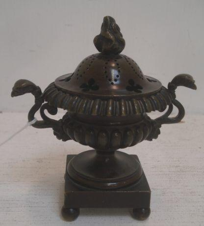 A small Regency bronze campana shape pot pourri vase and cover, with twin side handles, on a square plinth base and ball feet, 11cm.