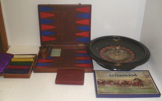 A vintage roulette wheel, cloth, case of gaming chips, ball and rake, 'Corinthian' The Master board, boxed, backgammon board and other vintage games.