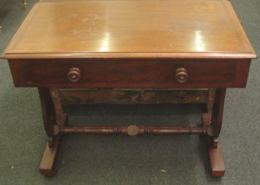 An early Victorian mahogany side table, the rectangular top originally with a gallery, having a frieze drawer, on shaped end standards, trestle bases and with a turned stretcher, 91cm.