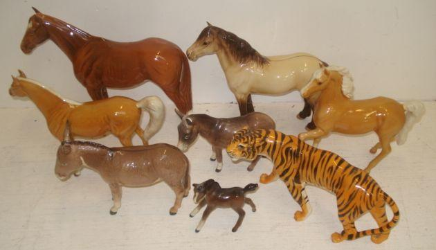 A collection of seven Beswick figures of horses, donkeys and foals and another of a tiger. (8)