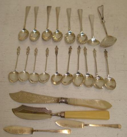 A set of six late Victorian silver 'apostle' coffee spoons,Birmingham 1899, a similar set and the following silver, six George III wigglework pattern teaspoons, with shell bowls, 1801-1807, two silver butter knives, Birmingham 1820, and Sheffield 1887, bone or mother of pearl handled, a pair of Art Deco butter knives, George IV salt spoon, Victorian sifter spoon, Sheffield 1894, with tubular handle, also six ivory handled dessert forks and five knives.