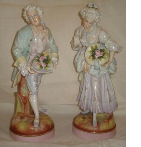 A pair of late 19th Century Plaue porcelain of figures, of a fashionable couple in 18th Century dress, on circular bases, minor losses, 40cm.