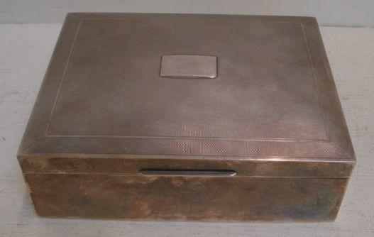 A modern silver cigar box, H Bros, Birmingham 1958, the hinged slightly domed engine turned cover with a vacant cartouche, 16 x 20.5cm.