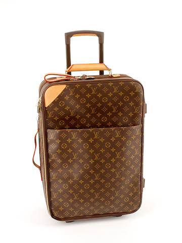 A Louis Vuitton brown and tan monogram rolling suitcase