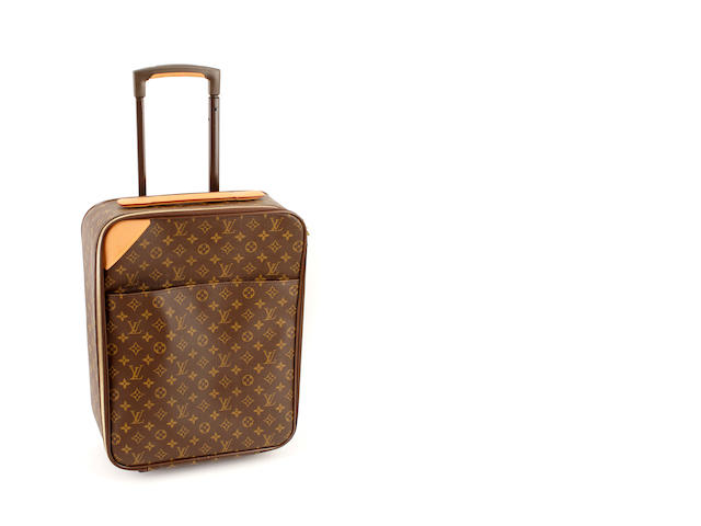A small Louis Vuitton brown and tan monogram rolling suitcase