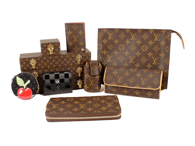 Eleven Louis Vuitton items - including a mobile case, purses and watch cases, all but one monogrammed
