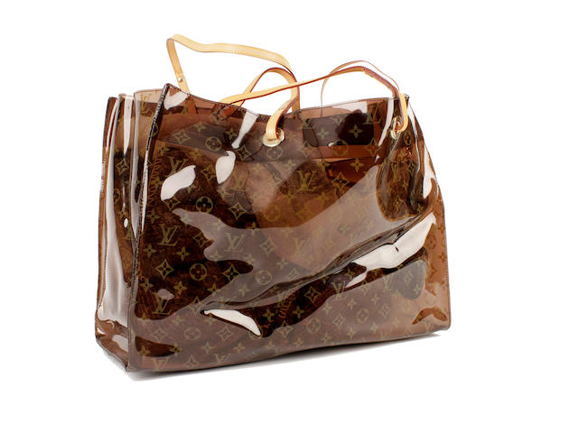 A Louis Vuitton large monogram plastic beach bag with attached purse