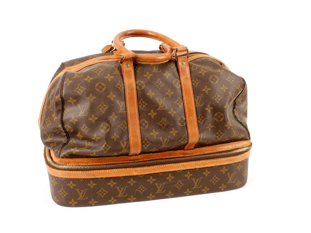 A Louis Vuitton brown and tan monogram bowler style hold-all