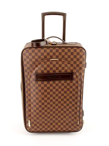 A Louis Vuitton damier rolling suitcase