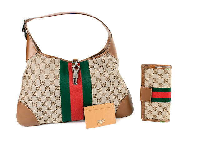 A Gucci tan leather and monogrammed canvas bag