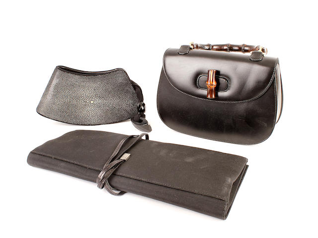 Three designer bags - a black shagreen Armani bag, a black leather Gucci bag, and a Gucci black clutch