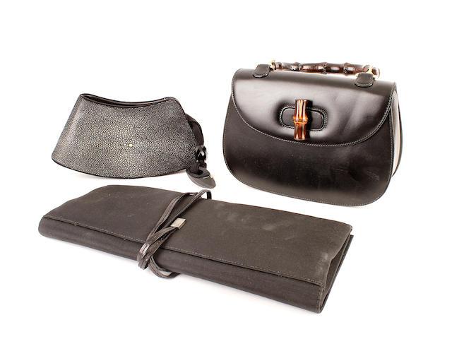 Three designer bags - a black shagreen Armani bag, a black leather Gucci bag, and a Gucci black clutch