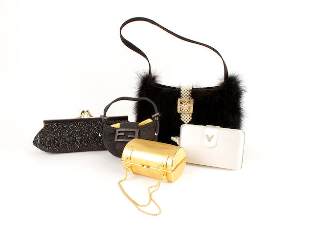 Five designer bags - a cream satin Valentino, a black ostrich feather Valentino, a Fendi jersey bag, a Maud Frizon glitter bag and a gold coloured hardcase bag